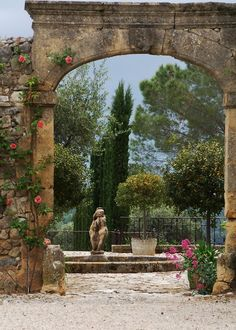 Beautiful architectural arch with climbing roses...garden in Provence.