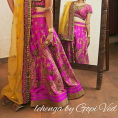Pink and yellow bridal lehenga. Indian wedding clothes
