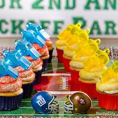 Turn whistle favors into cupcake decorations in the colors of the competing teams.
