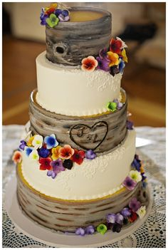 """Rustic Wedding Cake- initials """"carved"""" into a tree cake. Personally I don't know if I would do this, but I'm sorry, this is adorable!!! The more I think about it, the more I think I might do it. :) wedding cakes rustic, colorful flowers, tree cake, country weddings, initi carv, rustic weddings, rustic wedding cakes, country wedding cakes, cake toppers"""
