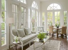 Phoebe Howard Porch. Don't love the decorating but I love how bright and open this porch is. A little too formal for my tastes.