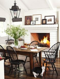 gorgeous fireplace...would be nice to have one in the dining room, except we never use the dining room!!!  With Love From Kat: White Picket Fence