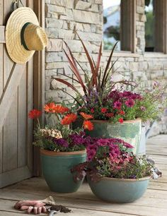 """Cheerful Color  This colorful arrangement of containers make a cheerful front porch.This is a great way to say """"welcome"""" on your porch.  There are plants for sun and shade so you're not limited to what you can plant and by planting in containers you can move them around easily as well as change the flowers to coincide with the seasons."""