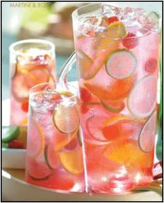 Raspberry Tequila Sangria...champagne, triple sec, tequila, raspberries...shall I continue or is that enough to convince ya'll? It did the trick for me!!! What a gorgeous presentation.