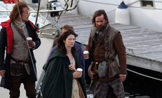 In pictures: Outlander stars film end of first series in Scottish town Troon - Scotland Now - (Caitriona Balfe is like, What are you doing, taking pictures of me!?!?!) #Outlander #Starz with Sam Heughan and Ducan LaCroix