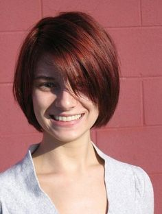 short red hairstyle with bangs