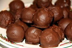 """Another old fashioned heritage confection, """"Martha Washington Candy"""" is a rich mixture of buttery coconut and condensed milk with pecans, rolled into a tight ball and dipped in chocolate."""