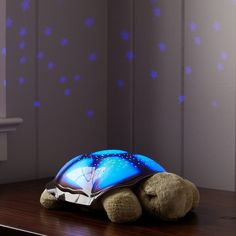 Cloud B Twilight Turtle ($35 USD) - Create a magical, serene nightscape in your child's room with this cuddly turtle. In soothing colors, he projects a starry night sky from his patterned shell onto bedroom walls and ceilings, including eight major constellations that parents and kids can identify together using the illustrated Star Guide.  Turtles is plush and soft with a sturdy plastic shell. Features eight major constellations, including the Big Dipper and the Big Bear.