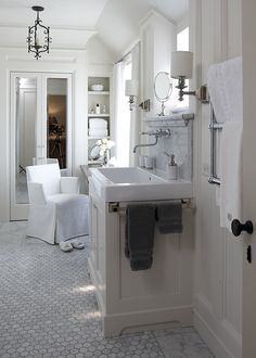White and marble bath by Tracery Interiors