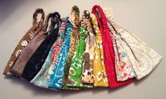 Assorted convertible headscarves / headbands.  Fun prints and colors! Great for yoga.  2013 Faire