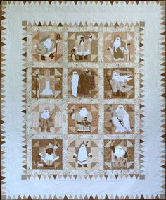 """Classic Santas"" quilt by Sue Garman, done entirely in white, off-white, creams, tans, and taupe"