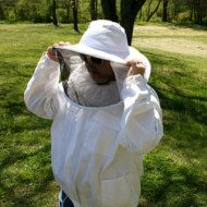 Bee keeper Annie, preparing to inspect the hives at Happy Acres Apiary
