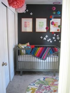 A charcoal gray nursery with a rainbow of colors for some fun.
