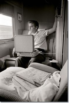 Elvis Presley listening to his portable record player in 1956.