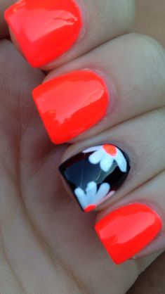 Orange nails with black accent nail with white daisies! Cute for summer!