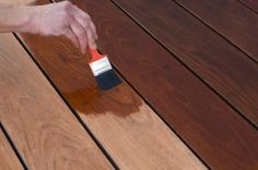 How To: Stain a Wood Deck  - A DIY guide by Bob Vila