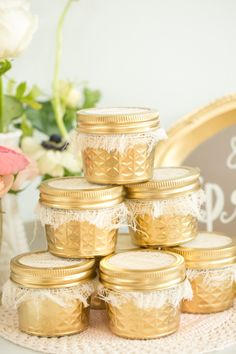 Gold jar wedding favors // photo by Amalie Orrange // styling by Weddings by 2+Hue.