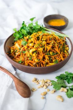 Bombay Carrot Salad with cashews and raisins, tossed in a fragrant Indian Curry dressing. Healthy and vegan this recipe is so EASY to make, and can be made-ahead. #carrotsalad #carrotslaw #vegancarrotsalad #healthycarrotsalad