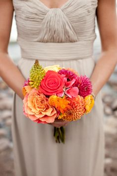 bright bridesmaid bouquet and a neutral dress