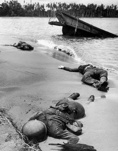 The bodies of three dead American soldiers in the sand on the shore of Buna Beach, New Guinea, after a Japanese attack. 1943.