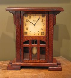 Highland Bungalow Clock. 17″ Tall, 15″ Wide, 6″ Deep. 6″ Face. Quarter-sawn Oak, Medium-dark Finish $600.