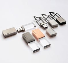 Empty Memory.  Jewellery collection by London designers Logical Art conceals a USB memory stick. stainless steel and finished by hand in white, black or pink gold.