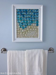 Wall Art made with a glass frame, painted background and glass marbles.
