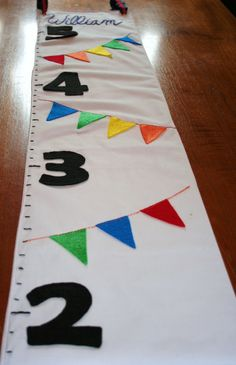 A customizable and personalized fabric growth chart is perfect for charting your growing little one.