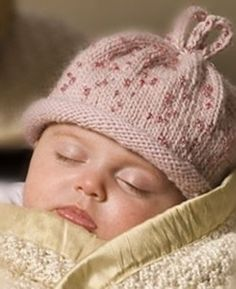 This knit baby hat features seed beads to create a unique and fun design.