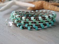I just made two wrap bracelets like this.  lovely.
