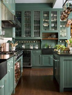 Entire kitchen lay out is awesome but with Carrara marble countertops & Carrara subway tile backsplash & the cabinets a blue-grey color.