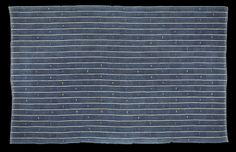 FR561 - Subtle and beautiful chief's robe cloth from the Abron or Koulango peoples of the Bondoukou region in north eastern Côte D'Ivoire. Unique minimal design achieved by regular blocks of narrow white weft stripes that combine with the white pinstripes in the warp to produce blocks of blue and white check that alternate regularly with striped areas of equal size. http://www.adireafricantextiles.com/francophone4.htm