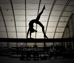 gymnast on balance beam, women's gymnastics, silhouette, cool sports photography action photo m.5.2