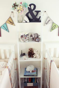 Cute way to separate cribs in a twin nursery. Just add more space add they get older!