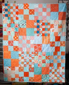 "I love blues with orange. Checker board style 12.5"" blocks. By  jenib320 on flickr"