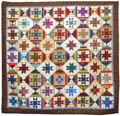 Ohio Stars and Courthouse Steps quilt by Sally Schneider