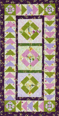 Showcase fussy-cut bird designs in uneven Nine-Patch blocks and frame them with Flying Geese units in a tabletop quilt.