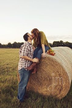 hay bale pose - engagement pictures, leading to farm wedding?