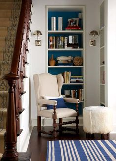 cozy reading nook next to a great staircase.