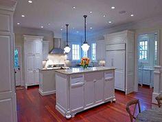 white kitchen, stainless hood.