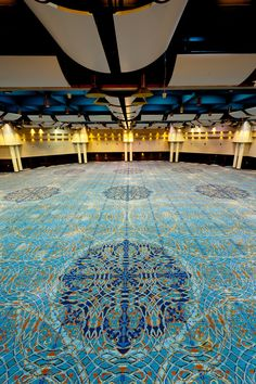 La Nouvelle ballroom in New Orleans Convention Center.  Large wrought iron and fleur-de-lis medallions interlace throughout the interior.