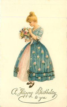 A FELIZ CUMPLEAÑOS chica vestida de azul sostiene el ramo de flores