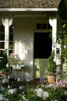 welcoming porch w/beautiful, happy flowers