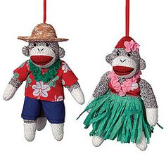 Outfitted in Hawaiian garb this set of 2 adorable knit sock monkeys is ready to luau at a moment's notice.