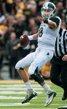 Sophomore quarterback Connor Cook directs teammates before throwing the football during the game against Iowa, Oct. 5, 2013, at Kinnick Stad...