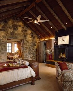 Master bedroom, w/sitting room off to side...stone. wood ceilings, fireplace...I'm never leaving...