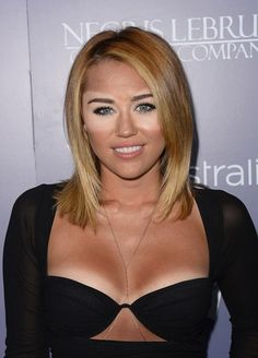 Miley Cyrus Tan Lines! It's the eyes. :D