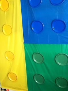 Lego Wall!!! Use Dollar Tree table cloths and plates to decorate a wall for a Lego themed party!!! Genius!!!