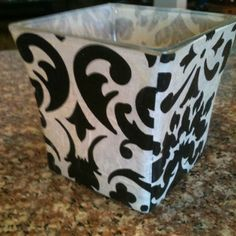 Recycled candle jar covered with decorative tissue paper for semi translucent effect.