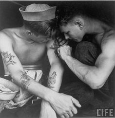 Sexy sailors getting tattoos